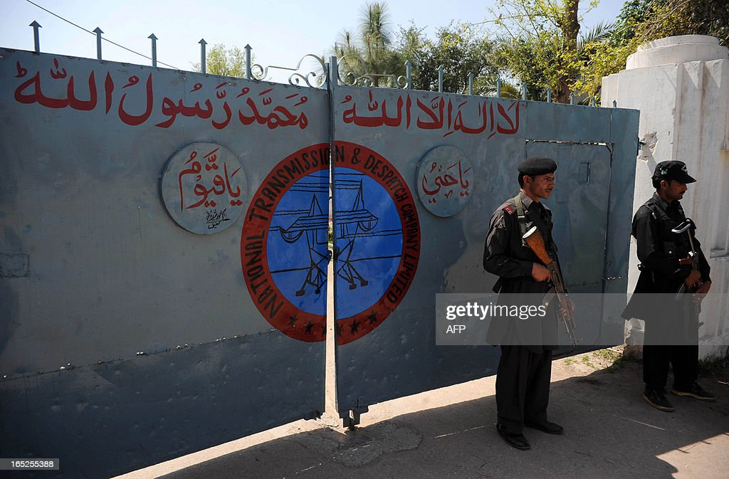 Pakistani security personnel stand guard outside an electricity power plant following an attack by gunmen in Badh Bher, a suburb of Peshawar on April 2, 2013. Dozens of gunmen attacked an electricity plant in northwest Pakistan, killing seven people and disrupting power to 100,000 people overnight, officials said.