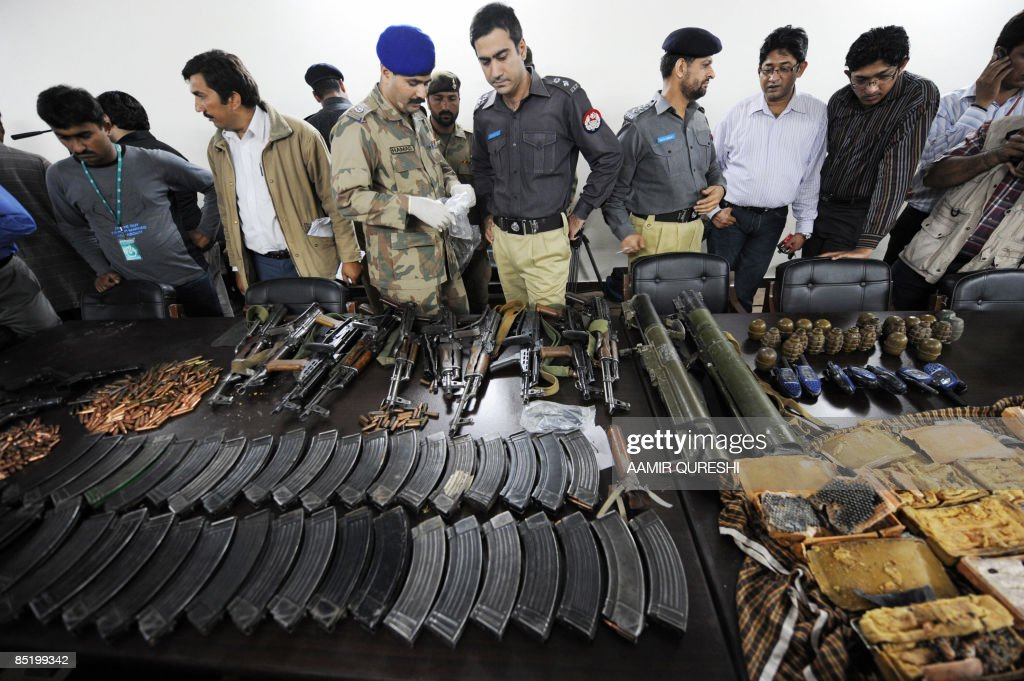 Pakistani securuty officials display the weapons used by gunmen during an attack on the Sri Lankan cricket team in Lahore on March 3, 2009. Attackers armed with guns and grenades launched a brazen assault on Sri Lanka's cricket team in Pakistan on March 3, killing eight people and wounding seven members of the squad. The attack in the city of Lahore sparked condemnation from around the world and threw a massive question mark over the future of the game in the troubled nation -- a co-host for the 2011 cricket World Cup. AFP PHOTO/ Aamir Qureshi