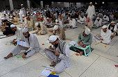 Pakistani seminary students take a midterm exam at the Islamic Jamia Binoria seminary in Karachi on March 8 2014 More than 1700 students took the...