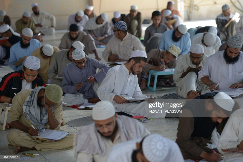 Pakistani seminary students take their first semester exam at the Islamic Jamia Binoria seminary in Karachi on December 7 2013 More than 3300...