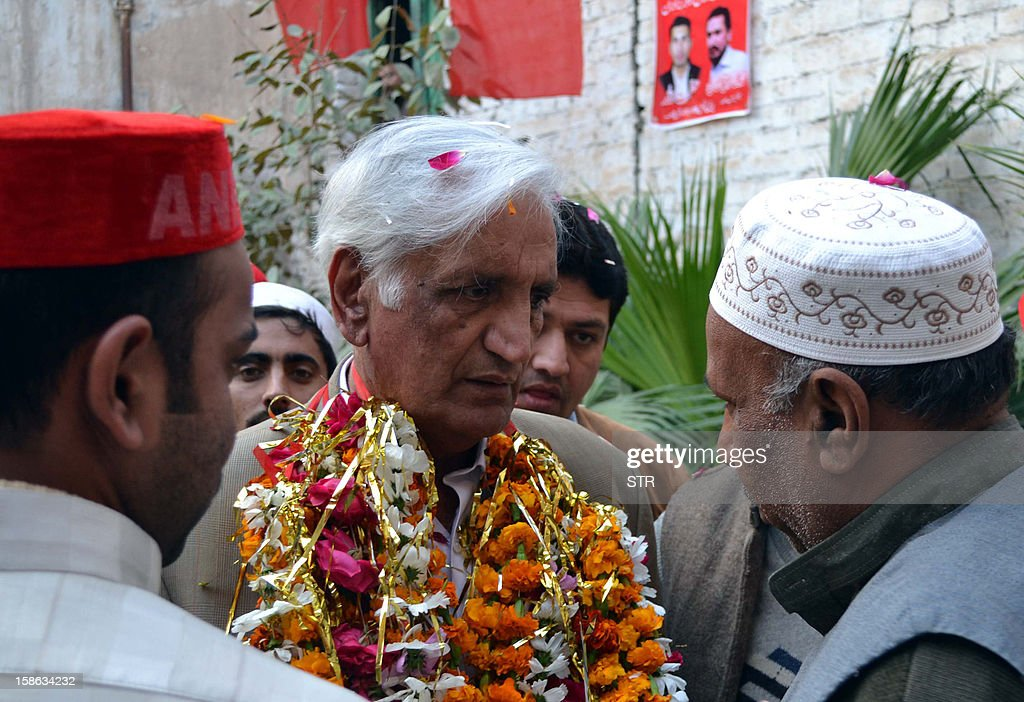 Pakistani senior minister of the provincial government, Bashir Bilour meets with party activists on his arrival for a public meeting in Peshawar on December 22, 2012, before a suicide attack . A suicide bomber blew himself up at a meeting of the political party that rules Pakistan's northwestern Khyber Pakhtunkhwa province, killing six people and wounding 21, officials said.