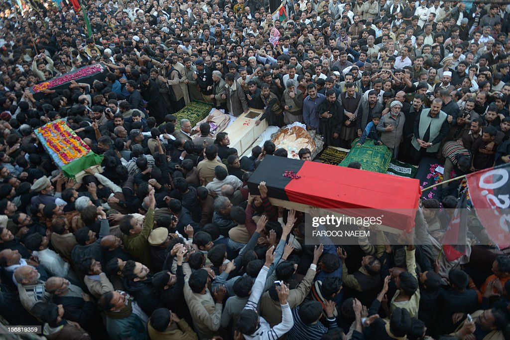 Pakistani Shiite and Sunni Muslims gather as coffin of bomb blast victims arrive for the funeral prayers in Rawalpindi on November 22, 2012. Muslim leaders gathered for a rare summit in Islamabad on Thursday as militant attacks killed 36 people across the country on one of the deadliest days of violence claimed by the Taliban in months. AFP PHOTO/Farooq NAEEM