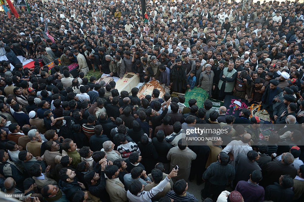 Pakistani Shiite and Sunni Muslims gather during funeral prayers for bomb blast victims in Rawalpindi on November 22, 2012. Muslim leaders gathered for a rare summit in Islamabad on Thursday as militant attacks killed 36 people across the country on one of the deadliest days of violence claimed by the Taliban in months. AFP PHOTO/Farooq NAEEM