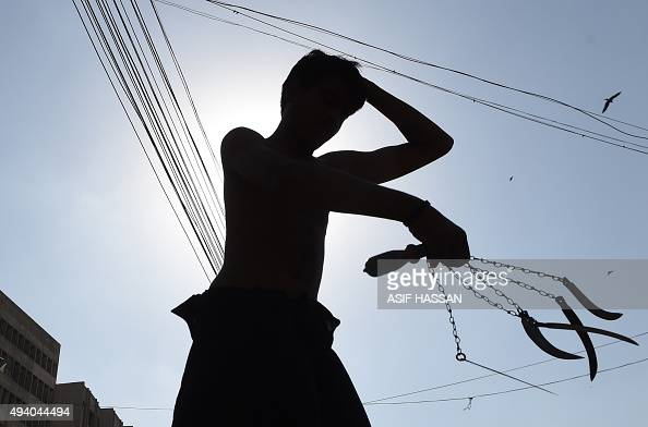 A Pakistani Shiite Muslim devotee takes part in ritual selfflagellation during the Ashura procession to commemorate the martyrdom of Imam Hussain the...