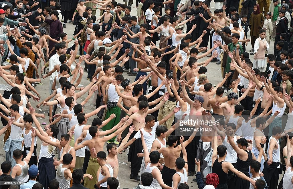 Pakistani Shiite Muslim devotees beat their chests during a religious procession marking Ashura in Quetta on November 4 2014 Ashura mourns the death...