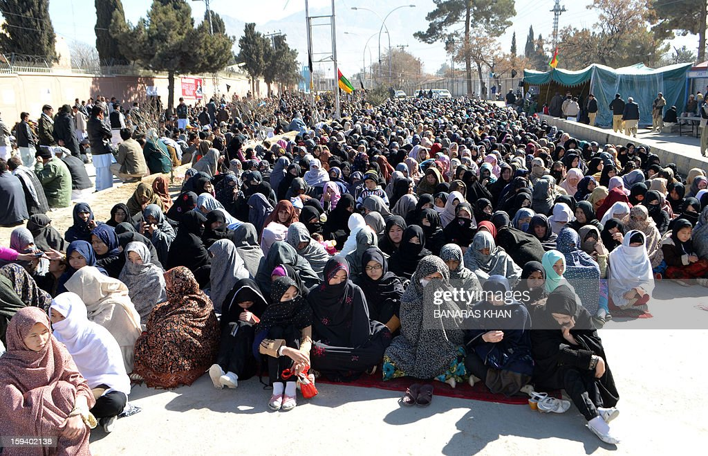 Pakistani Shiite Muslim families demonstrate and sit along with of coffins of bomb blast victims in Quetta on January 13, 2013, on the third day of protest. Pakistan's Prime Minister Raja Pervez Ashraf arrived, in the southwestern city of Quetta to meet Shiite Muslim families refusing to bury their dead after devastating bombings. AFP PHOTO/ Banaras KHAN