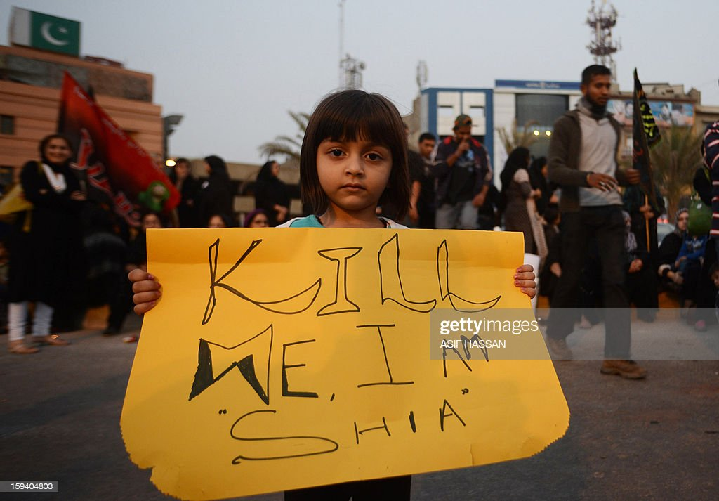 A Pakistani Shiite Muslim girl holds placard during a protest against the twin bombings in Quetta, in Karachi on January 2013. Pakistan's Prime Minister Raja Pervez Ashraf arrived in the southwestern city of Quetta to meet Shiite Muslim families refusing to bury their dead after devastating bombings, officials said. AFP PHOTO/ Asif HASSAN