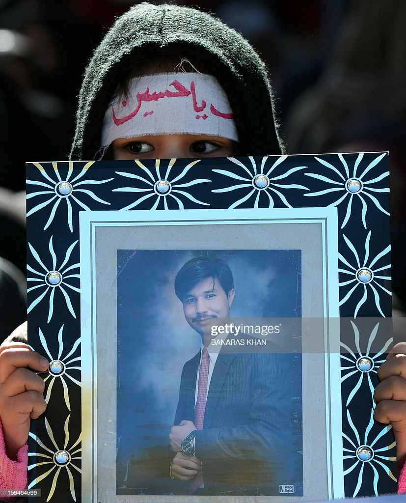 A Pakistani Shiite Muslim holds a photograph of a blast victim during a protest in Quetta on January 14, 2013 against the killing of their community members. Thousands of Shiite Muslims from Pakistan's minority Hazara community ended a nearly four-day protest after Islamabad caved into their demands for protection by sacking the provincial government. Protesters refused to bury the victims of Pakistan's worst single attack on Shiites, which killed 92 people in the southwestern city of Quetta last January 10. AFP PHOTO/ BANARAS KHAN