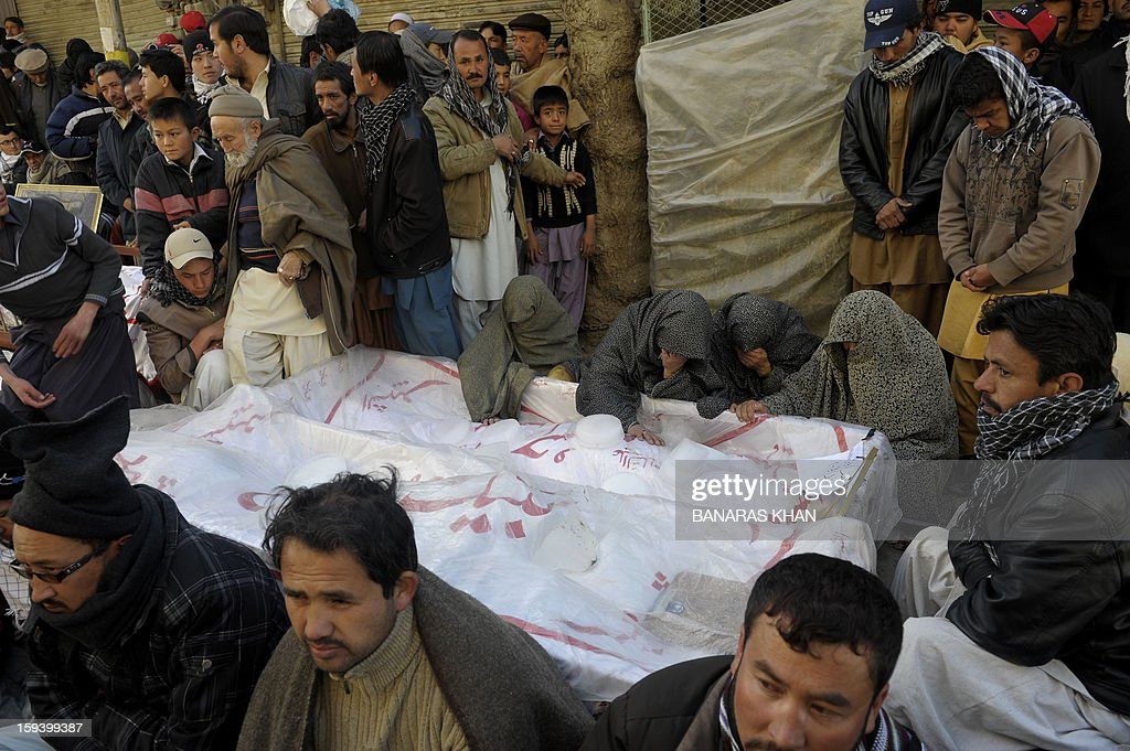 Pakistani Shiite Muslim mourn the death of relatives as they demonstrate along with of coffins of bomb blast victims in Quetta on January 13, 2013, on the third day of protest. Pakistan's Prime Minister Raja Pervez Ashraf arrived, in the southwestern city of Quetta to meet Shiite Muslim families refusing to bury their dead after devastating bombings. AFP PHOTO/ Banaras KHAN