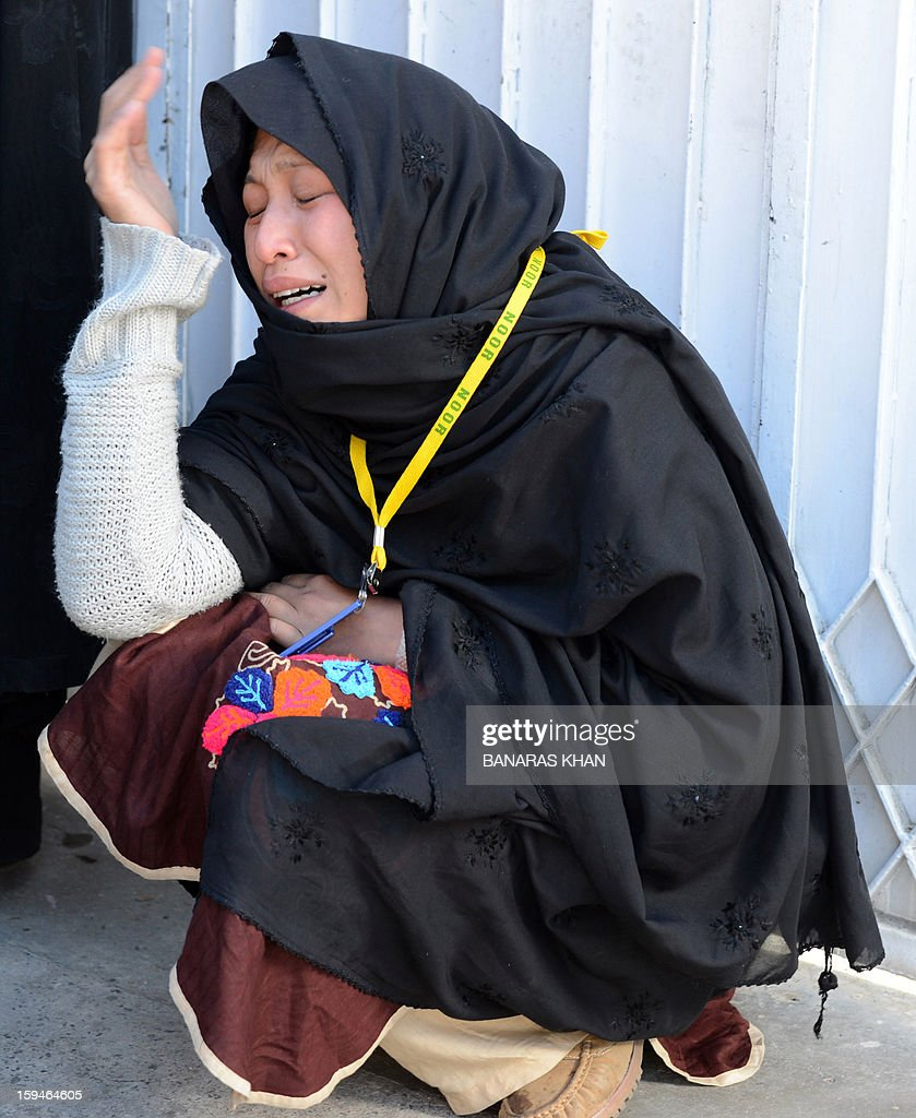 A Pakistani Shiite Muslim mourner cries after after ending her protest in Quetta on January 14, 2013. Thousands of Shiite Muslims from Pakistan's minority Hazara community ended a nearly four-day protest after Islamabad caved into their demands for protection by sacking the provincial government. Protesters refused to bury the victims of Pakistan's worst single attack on Shiites, which killed 92 people in the southwestern city of Quetta last January 10. AFP PHOTO/ BANARAS KHAN