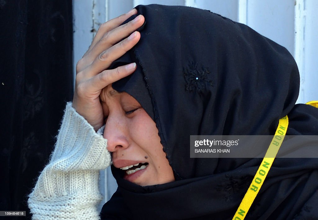 A Pakistani Shiite Muslim mourner cries after after ending her protest in Quetta on January 14, 2013. Thousands of Shiite Muslims from Pakistan's minority Hazara community ended a nearly four-day protest after Islamabad caved into their demands for protection by sacking the provincial government. Protesters refused to bury the victims of Pakistan's worst single attack on Shiites, which killed 92 people in the southwestern city of Quetta last January 10.
