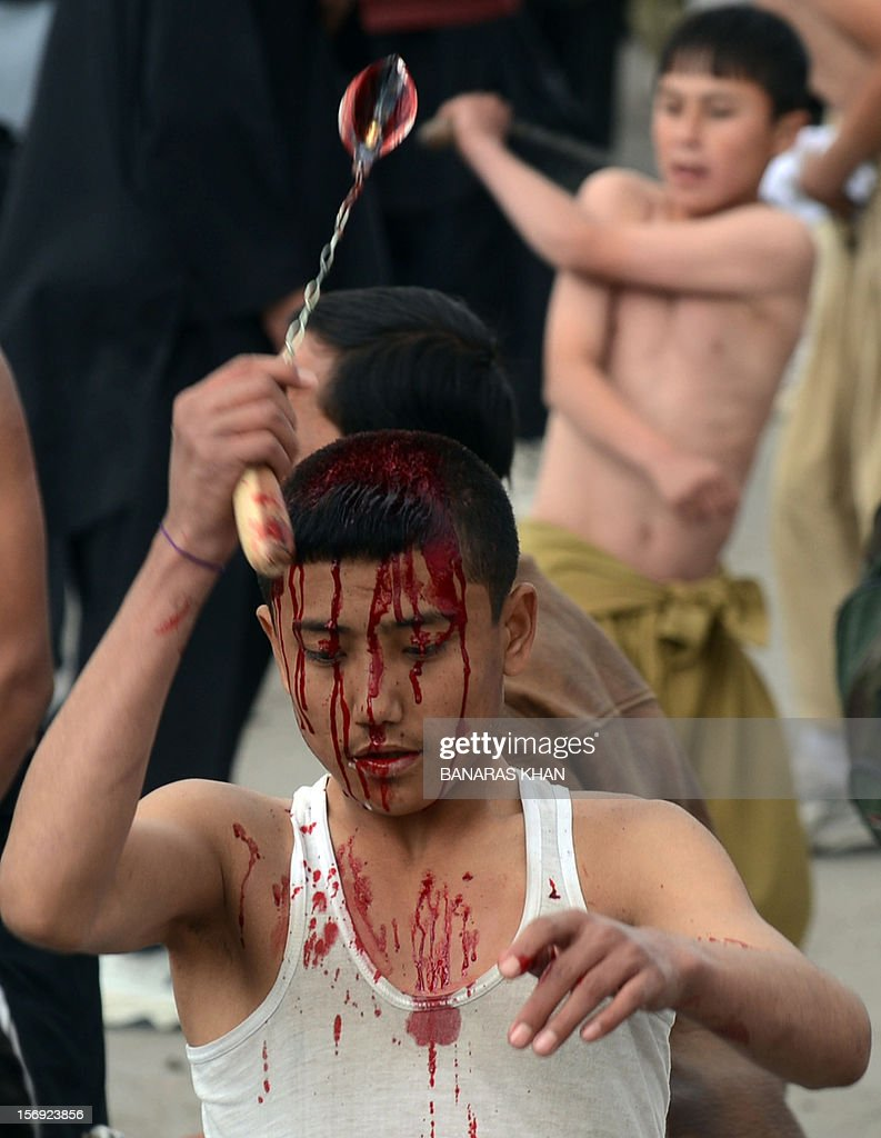 A Pakistani Shiite Muslim mourner performs religious rituals during an Ashura procession in Quetta on November 25, 2012. A bomb attack on a Shiite Muslim procession killed five mourners and wounded more than 80 in northwest Pakistan on November 25 as Shiites marked their holiest day Ashura, officials said.