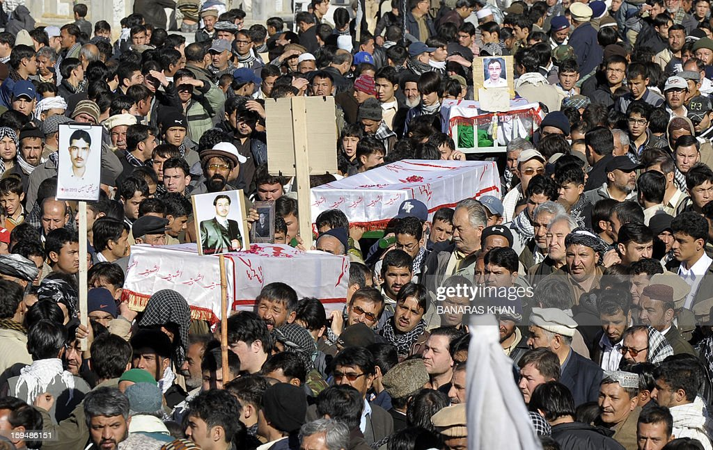Pakistani Shiite Muslim mourners carry the coffins of blast victims during their funeral after ending their protest in Quetta on January 14, 2013. Embattled Shiite Muslims Monday buried victims of the deadliest single attack on their community in Pakistan, ending a four-day protest to demand protection after the provincial government was sacked. Men, women and children spent four nights camped in freezing conditions, refusing to bury the victims of a twin suicide bombing that killed 92 people in a Shiite area of the southwestern city of Quetta last Thursday.