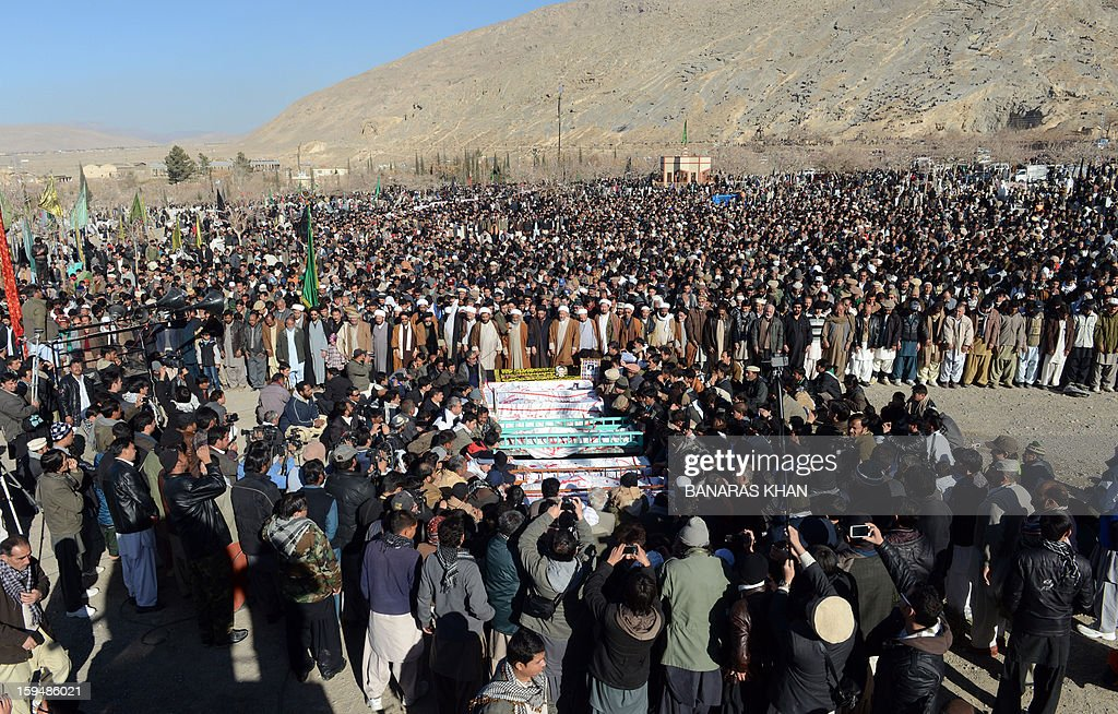 Pakistani Shiite Muslim mourners offer funeral prayers for blast victims after ending their protest in Quetta on January 14, 2013. Embattled Shiite Muslims Monday buried victims of the deadliest single attack on their community in Pakistan, ending a four-day protest to demand protection after the provincial government was sacked. Men, women and children spent four nights camped in freezing conditions, refusing to bury the victims of a twin suicide bombing that killed 92 people in a Shiite area of the southwestern city of Quetta last Thursday.