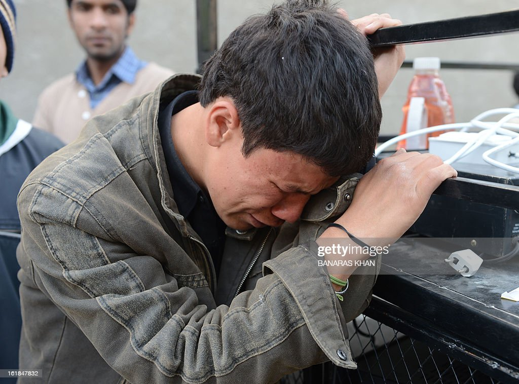 A Pakistani Shiite Muslim mourns the death of a relative as he gathers with the coffins of bomb attack victims during a protest in Quetta on February 17, 2013. The death toll from a devastating bomb attack on Shiite Muslims in southwest Pakistan rose to 81 Sunday, as the community threatened protests if swift action was not taken against the killers. AFP PHOTO/Banaras KHAN