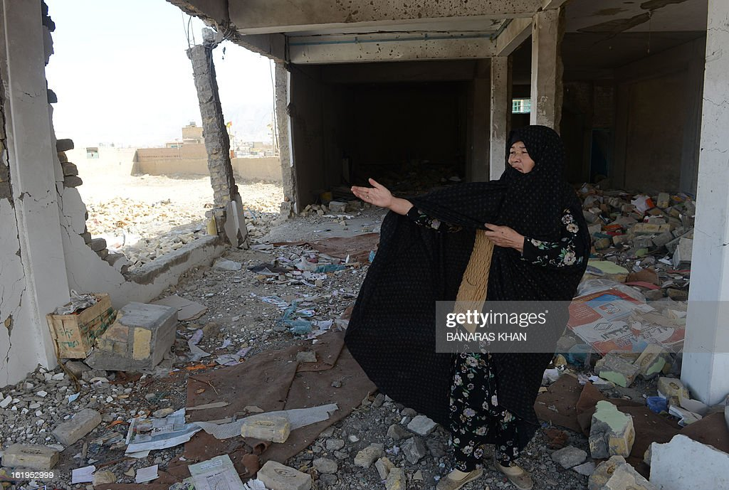 A Pakistani Shiite Muslim woman gestures as she stands at the site scene of a bomb attack site on the second day of protests in Quetta on February 18, 2013. Thousands of women refused Monday to bury victims of a bloody bombing and a strike shut down Pakistan's biggest city Karachi as protesters across the country demanded protection for Shiite Muslims. AFP HOTO/Banaras KHAN