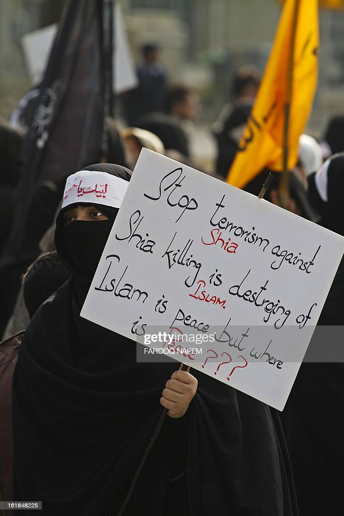 A Pakistani Shiite Muslim woman holds a placard at a protest march reacting against yesterday's bomb attack in Quetta, in Islamabad on February 17, 2013. The death toll from a devastating bomb attack on Shiite Muslims in southwest Pakistan rose to 81 Sunday, as the community threatened protests if swift action was not taken against the killers. AFP PHOTO/Farooq NAEEM