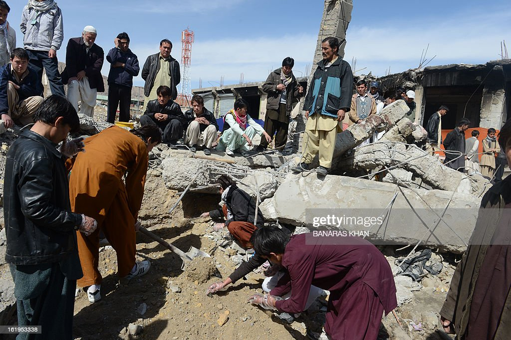 Pakistani Shiite Muslims are pictured amid debris from a February 16 bomb blast, in Quetta on February 18, 2013. Thousands of women refused Monday to bury victims of a bloody bombing and a strike shut down Pakistan's biggest city Karachi as protesters across the country demanded protection for Shiite Muslims. AFP HOTO/Banaras KHAN