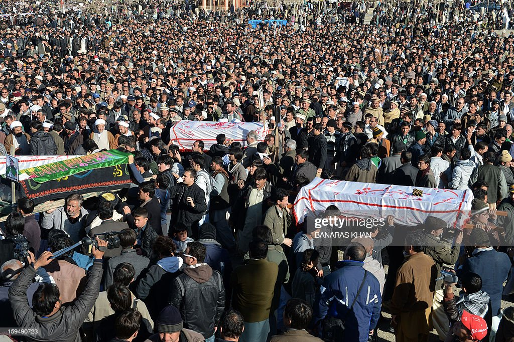 Pakistani Shiite Muslims carry the coffins of victims of the twin bombings during the funeral ceremony in Quetta on January 14, 2013. Embattled Shiite Muslims Monday buried victims of the deadliest single attack on their community in Pakistan, ending a four-day protest to demand protection after the provincial government was sacked. AFP PHOTO/Banaras KHAN
