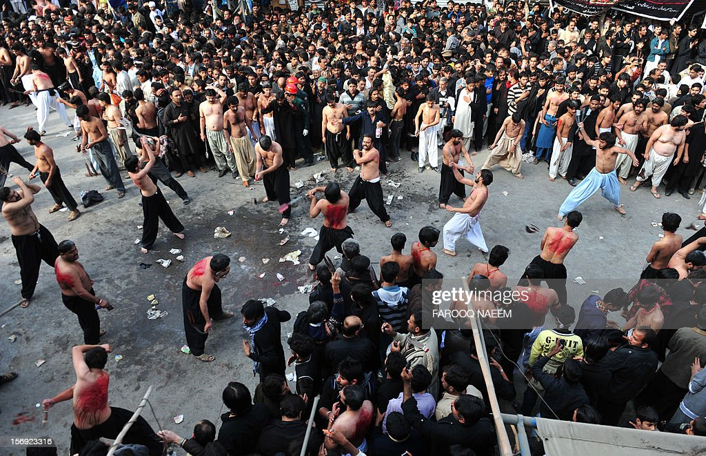Pakistani Shiite Muslims flagellate themselves during a religious procession in Rawalpindi on November 25, 2012. A bomb attack on a Shiite Muslim procession killed five mourners and wounded more than 80 in northwest Pakistan on November 25 as Shiites marked their holiest day Ashura, officials said.