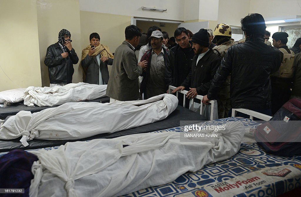 Pakistani Shiite Muslims gather at a hospital morgue to identify the remains of relatives killed in a bomb blast in Quetta on February 16, 2013. A remote-controlled bomb targeting Shiite Muslims killed 47 people including women and children and wounded more than 200 in Pakistan's insurgency-hit southwest on Saturday, police and officials said. AFP PHOTO/Banaras KHAN