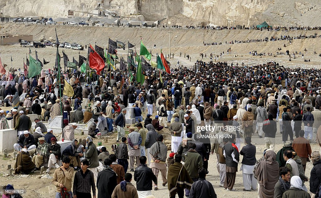 Pakistani Shiite Muslims gather during a mass burial ceremony in Quetta on February 20, 2013. Mass burials for 89 victims of a bomb attack targeting Pakistani Shiite Muslims began after three days of nationwide protests at the government's failure to tackle sectarian violence. AFP PHOTO/ Banaras KHAN