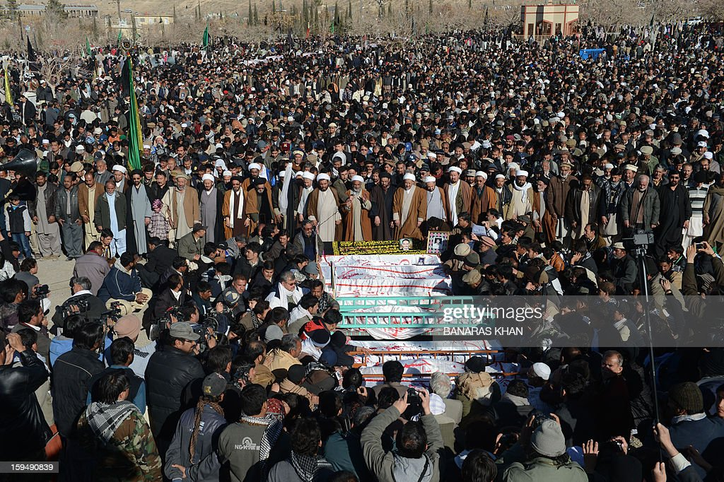 Pakistani Shiite Muslims gather for funeral ceremony of victims of the twin bombings in Quetta on January 14, 2013. Embattled Shiite Muslims Monday buried victims of the deadliest single attack on their community in Pakistan, ending a four-day protest to demand protection after the provincial government was sacked. AFP PHOTO/Banaras KHAN