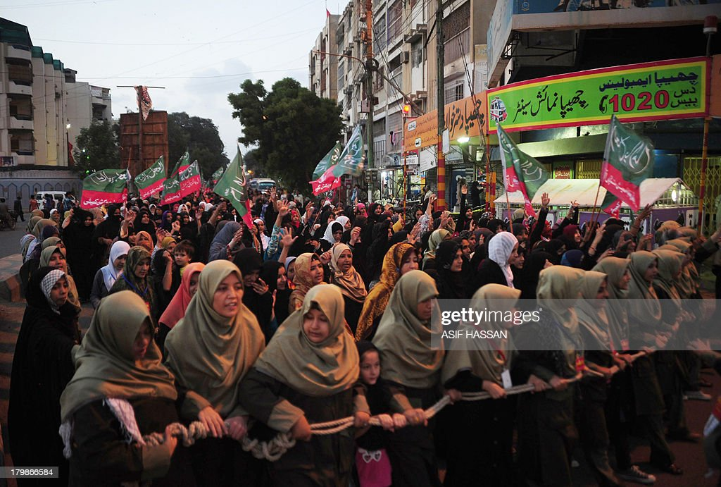 Pakistani Shiite Muslims march in a protest rally in Karachi on September 7, 2013, against the possible US strikes against Syria. As well as the stubborn international differences, the US administration is still scrambling to win backing from Congress for any action against Syria. AFP PHOTO/ Asif HASSAN