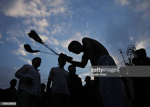 Pakistani Shiite Muslims observing self flagellation with knives during the main ashura procession on 10th Muharram in Lahore Shiites mark Ashura the...