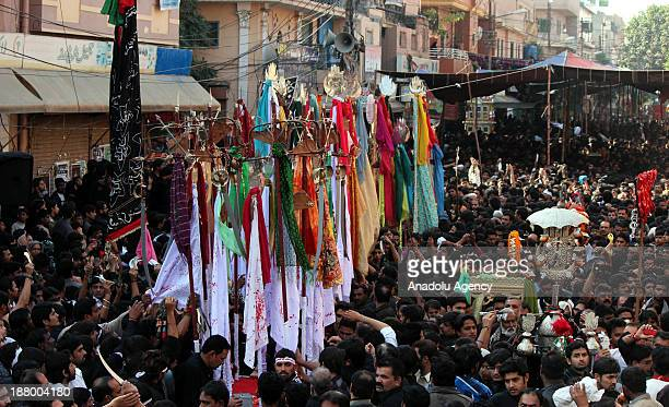 Pakistani Shiite Muslims participate in religious event held ahead of Ashura the day of mourning for the martyrdom of Husayn ibn Ali the grandson of...
