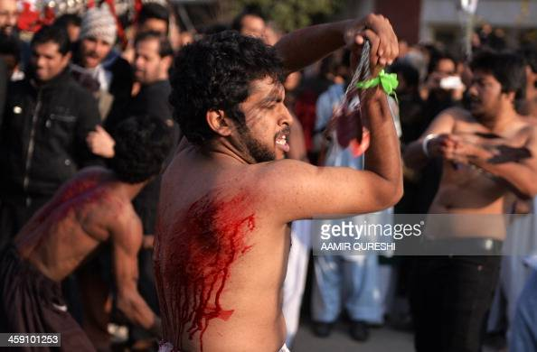 Pakistani Shiite Muslims participate in ritual selfflagellation during a religious procession in Islamabad on December 23 2013 Pakistani Shiite...