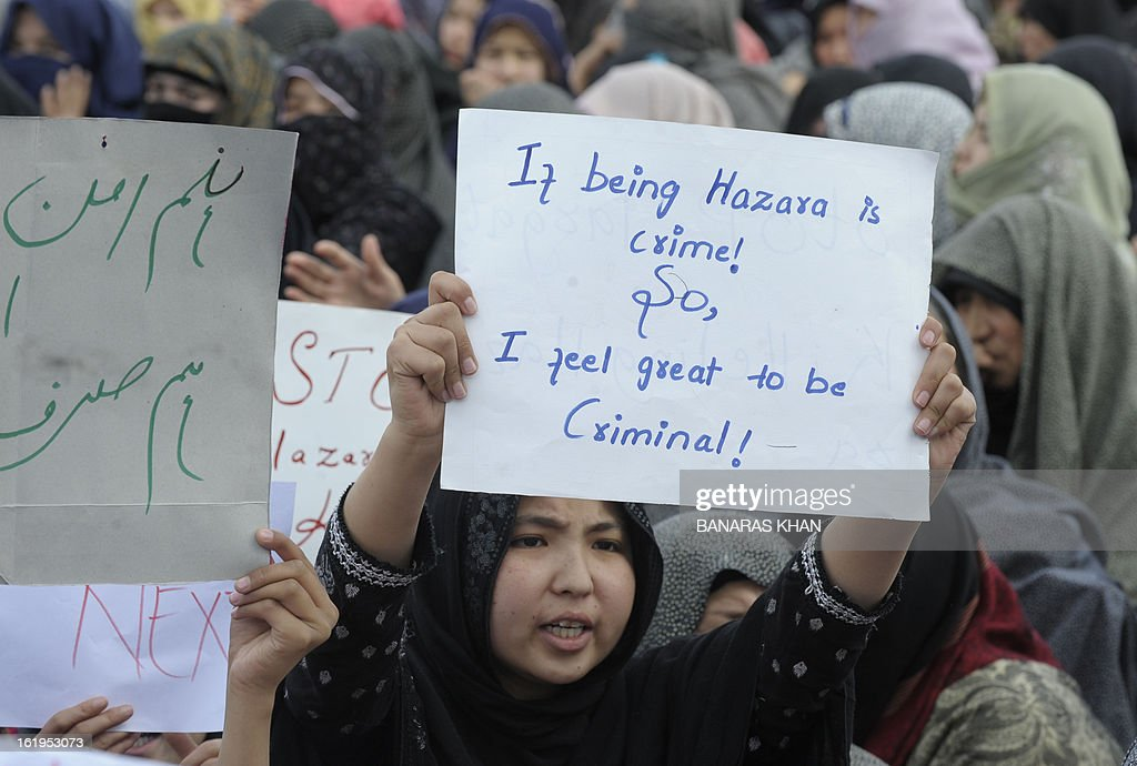 Pakistani Shiite Muslims shout slogans on the second day of protests against a devastating bomb attack in Quetta on February 18, 2013. Thousands of women refused Monday to bury victims of a bloody bombing and a strike shut down Pakistan's biggest city Karachi as protesters across the country demanded protection for Shiite Muslims. AFP HOTO/Banaras KHAN