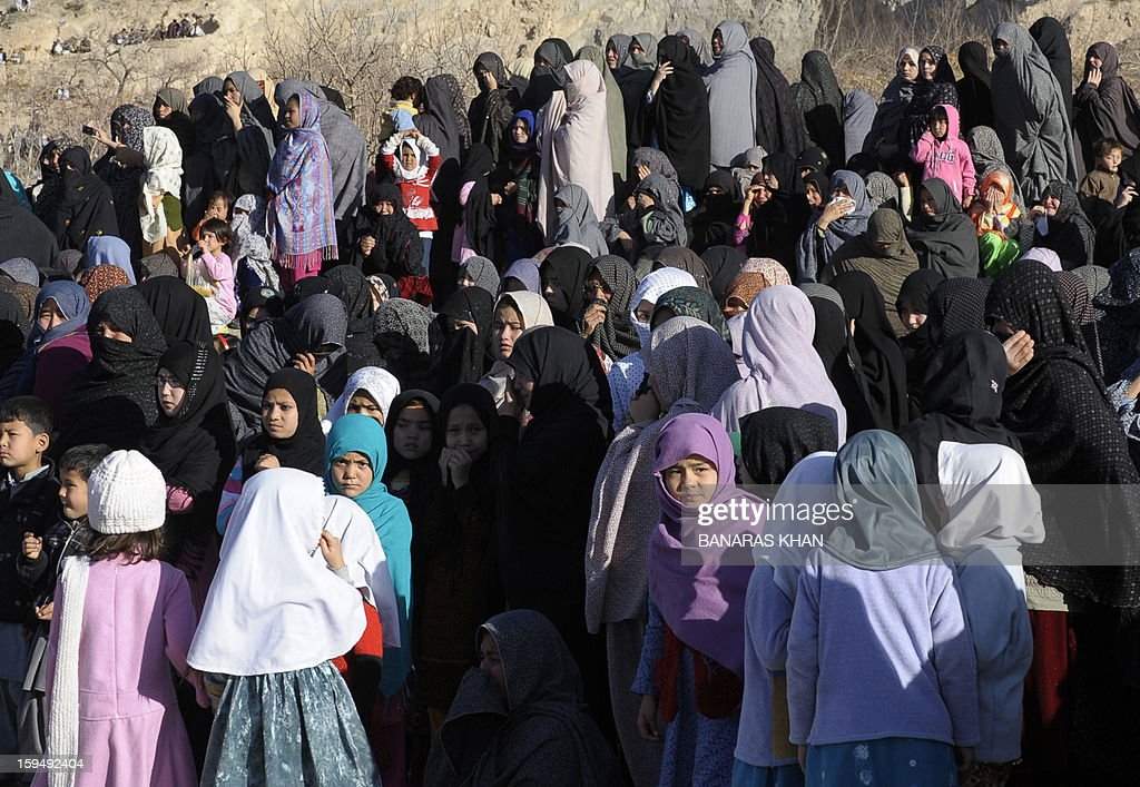 Pakistani Shiite Muslims women gather during the funeral ceremony of twin bomb blast victims in Quetta on January 14,2013. Embattled Shiite Muslims Monday buried victims of the deadliest single attack on their community in Pakistan, ending a four-day protest to demand protection after the provincial government was sacked. AFP PHOTO/Banaras KHAN