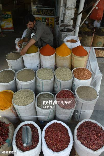 A Pakistani shopkeeper arranges food items at a market in Lahore on May 26 2017 Pakistan's economy expanded almost 53 percent in the last year the...