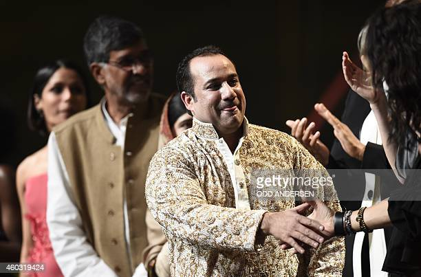 Pakistani singer Ustad Rahat Fateh Ali Khan shakes hands after performing at the Nobel Peace Prize Concert at the Oslo spectrum on December 11 2014...