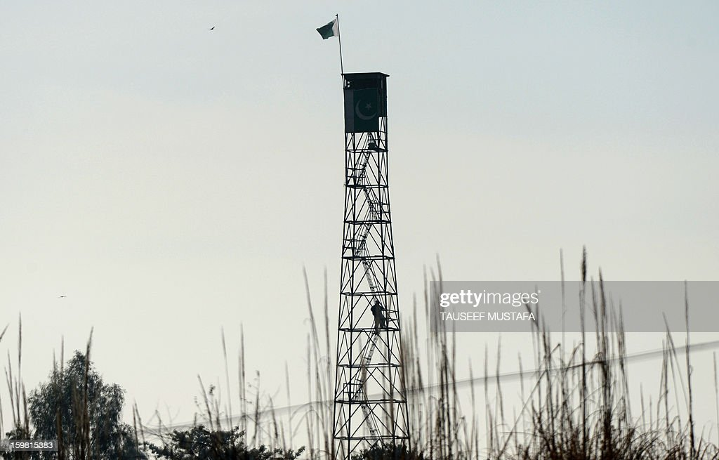 A Pakistani soldier climbs down from a watch tower near the India-Pakistan border in Suchit-Garh, some 36 kms southwest of Jammu, on January 21, 2013. On both sides of the de facto border in Kashmir, villagers living on one of the world's most dangerous flash points have special reason to fear the return of tension between India and Pakistan. The spike in cross-border firing in Kashmir -- a region claimed wholly by both India and Pakistan -- has seen five soldiers killed in recent days and threatened to unravel a fragile peace process that had begun to make progress. AFP PHOTO/ Tauseef MUSTAFA