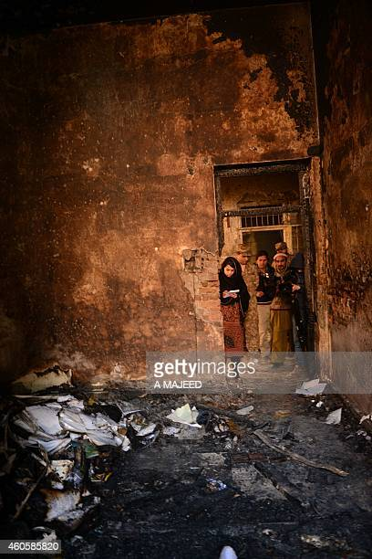 A Pakistani soldier shows the media a burnt classroom at an armyrun school a day after an attack by Taliban militants in Peshawar on December 17 2014...