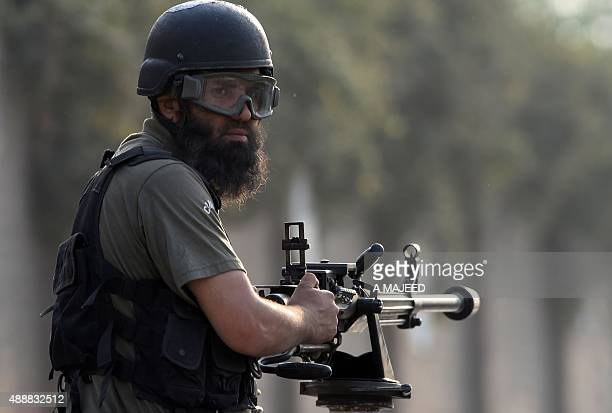 A Pakistani soldier takes position outside the Pakistan Air Force base after an attack by militants in Peshawar on September 18 2015 Militants...