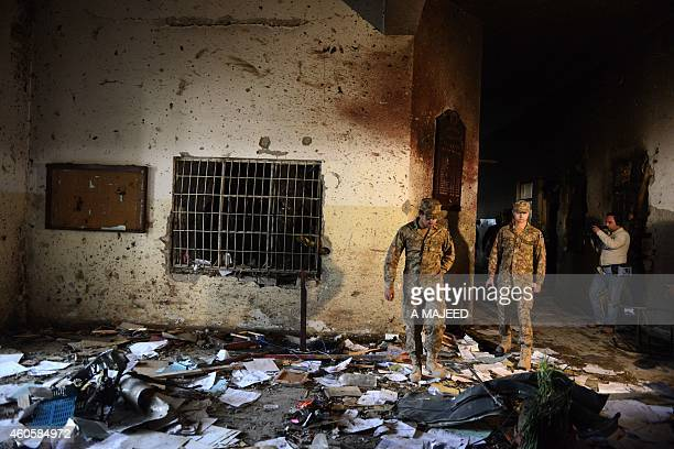 A Pakistani soldier walks amidst the debris in an armyrun school a day after an attack by Taliban militants in Peshawar on December 17 2014 Pakistan...