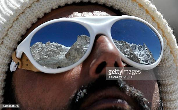 A Pakistani soldier wearing sunglasses looks on at the avalanche site during an ongoing operation at Gayari camp near the Siachen glacier on April 18...