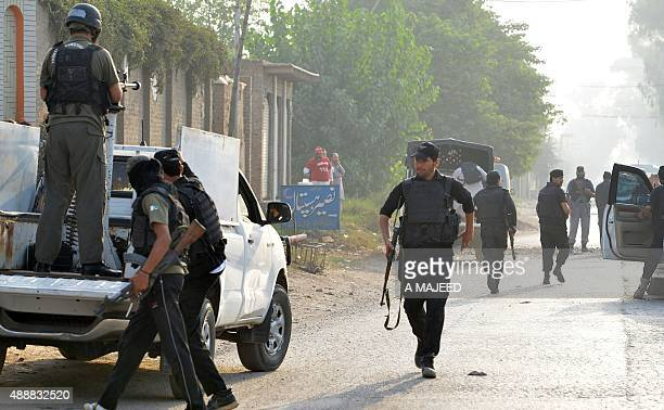 Pakistani soldiers and police commandos arrive to take position outside the Pakistan Air Force base after an attack by militants in Peshawar on...