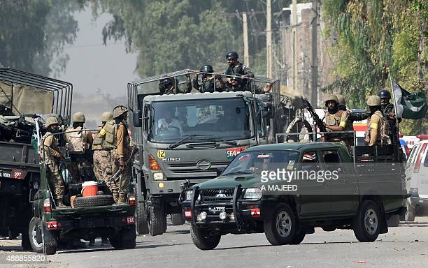 Pakistani soldiers arrive to take position outside a Pakistan Air Force base after an attack by militants in Peshawar on September 18 2015 Militants...