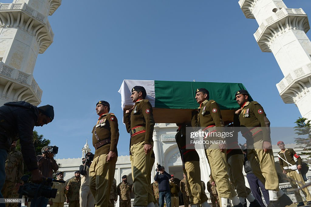 Pakistani soldiers carry the coffin of their fallen comrade Havildar (Sargeant) Mohyuddin, who was allegedly shot by Indian troops at the Hotspring sector in Battal in Pakistan-administered Kashmir, during his funeral in Jhelum some 100 kms of Islamabad on January 11, 2013. Pakistan on January 11 summoned the Indian ambassador to Islamabad to protest against the death of another Pakistani soldier in what it said was a second cross-border attack from Indian troops in Kashmir.