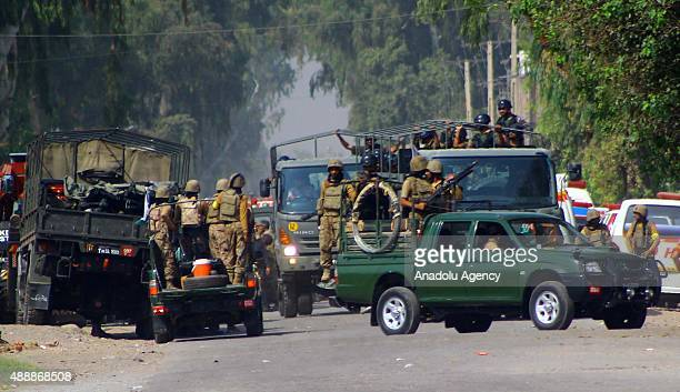 Pakistani soldiers cordon off the area outside an air force base attacked by Taliban militants at Badaber on the outskirts of the northwestern city...