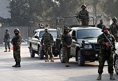 Pakistani soldiers cordon off the site of an attack by Taliban gunmen on a school in Peshawar on December 16 2014 At least 130 people were killed in...