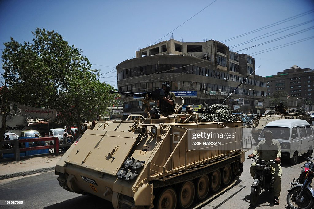 Pakistani soldiers in a armoured personnel carrier deploy near a voting station ahead of re-polling on National assembly seat NA250 in Karachi on May 18, 2013, where complaints of rigging and irregularities were reported in general election May 11. The army is set to be deployed at 43 polling stations of NA-250, PS-112 and PS-113 Karachi ahead of re-polling on May 19, a media report said. AFP PHOTO/Asif HASSAN