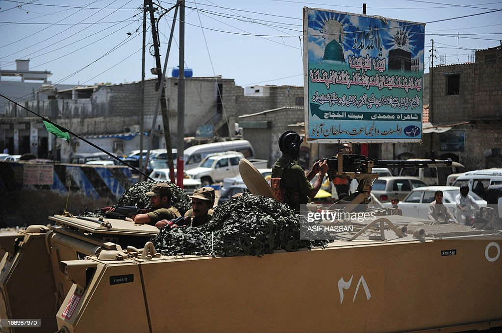 Pakistani soldiers in an armoured personnel carrier deploys near a voting station ahead of re-polling on National assembly seat NA250 in Karachi on May 18, 2013, where complaints of rigging and irregularities were reported in general election May 11. The army is set to be deployed at 43 polling stations of NA-250, PS-112 and PS-113 Karachi ahead of re-polling on May 19, a media report said. AFP PHOTO/Asif HASSAN