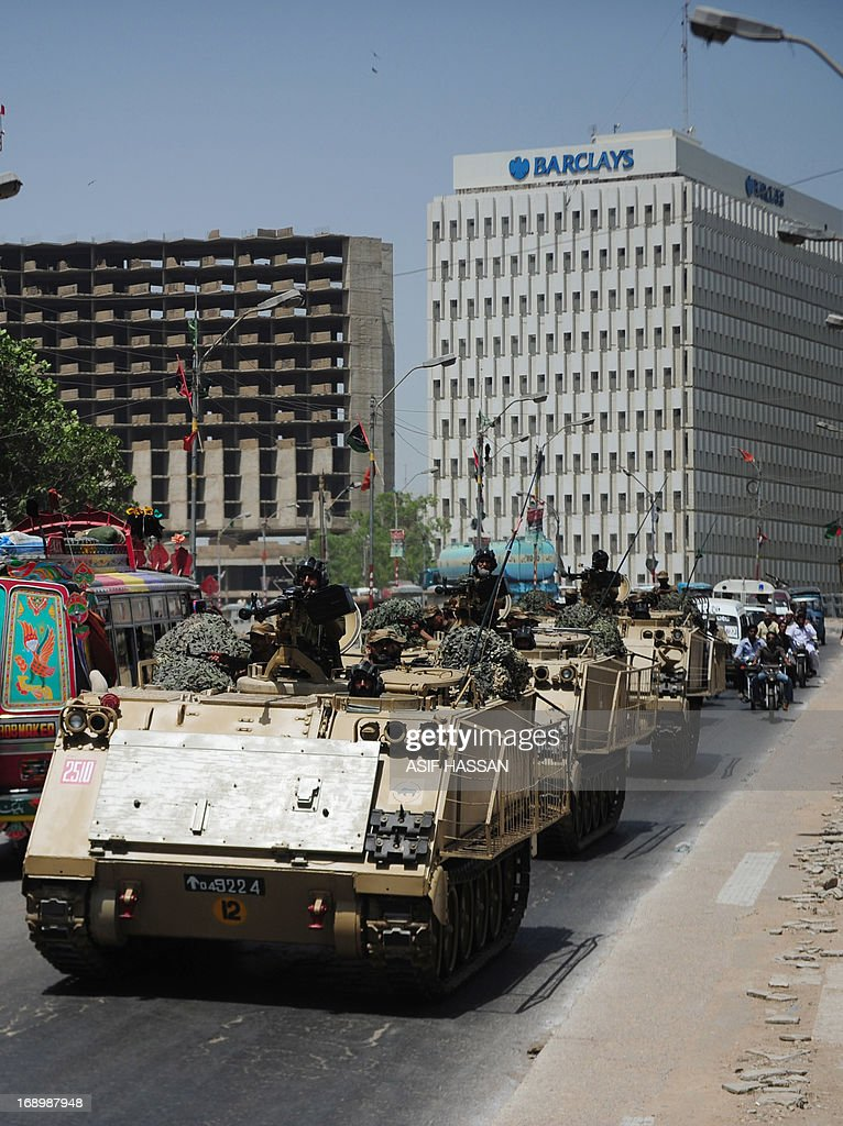 Pakistani soldiers in armoured personnel carriers deploy near a voting station ahead of re-polling on National assembly seat NA250 in Karachi on May 18, 2013, where complaints of rigging and irregularities were reported in general election May 11. The army is set to be deployed at 43 polling stations of NA-250, PS-112 and PS-113 Karachi ahead of re-polling on May 19, a media report said. AFP PHOTO/Asif HASSAN