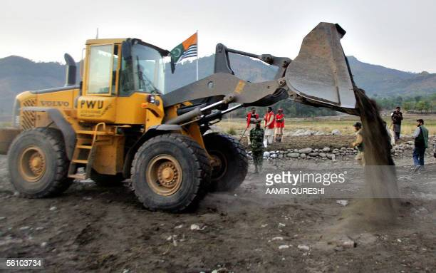 Pakistani soldiers level the ground with bulldozer in preparation for the border opening at Titri Note in Pakistan administered Kashmir 06 November...
