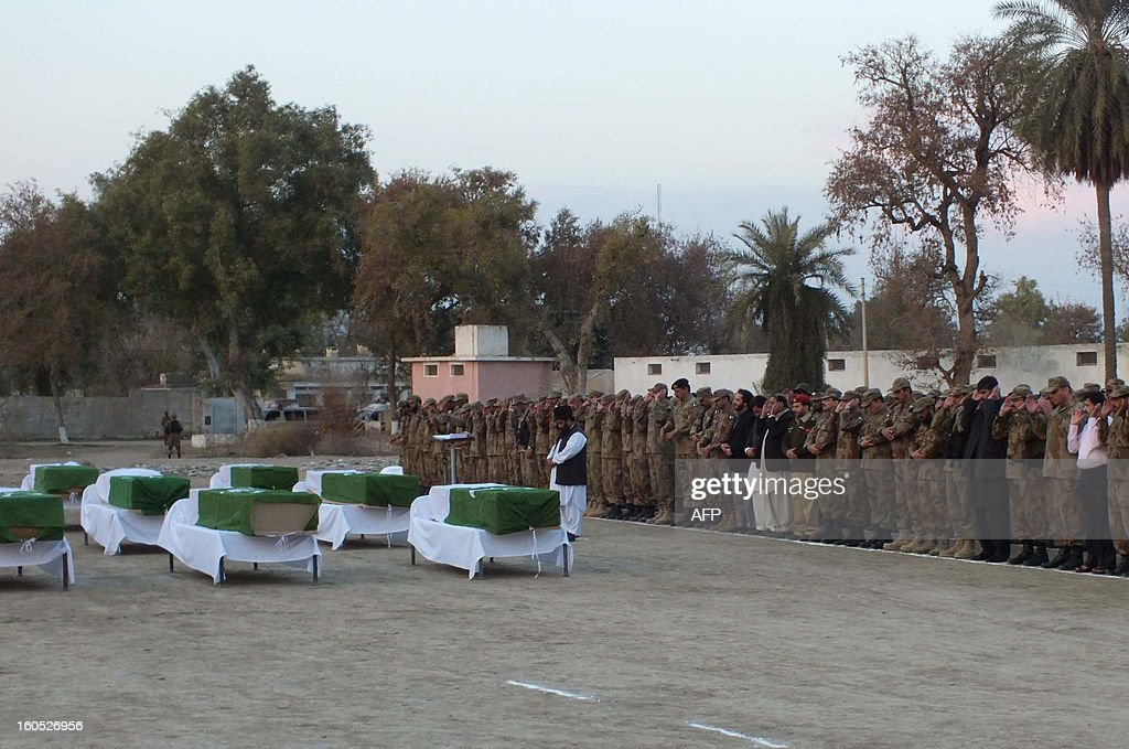 Pakistani soldiers offer funeral prayers for their fallen comrades killed in a suicide attack in Sari Norang on February 2, 2013. Suicide bombers attacked a military checkpost in Pakistan's troubled northwest on Saturday, killing 13 soldiers and 11 civilians, officials said, in an assault claimed by the Taliban. AFP PHOTO/Karim ULLAH